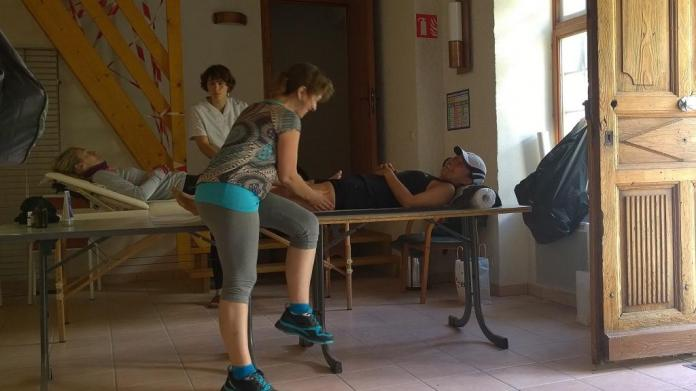 The Ninja Turtle enjoying a post-race massage from volunteering physiotherapists.