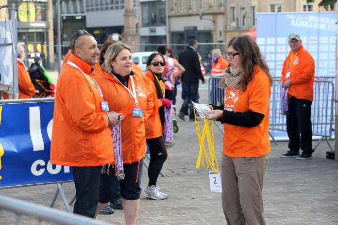 All the volunteers were armed with medals, ready to fling over their necks and herd them off as quickly as possible before the marathon runners arrived.